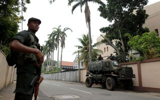 Soldiers stand guard outside the residence of cardinal Malcolm Ranjith, the archbishop of Colombo, in Colombo, Sri Lanka April 26, 2019. REUTERS/Thomas Peter