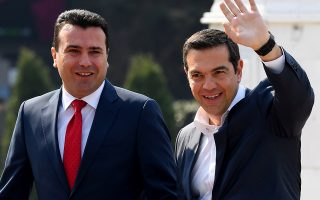 epa07479560 North Macedonian Prime Minister Zoran Zaev (L) and  Greek Prime Minister  Alexis Tsipras (R) during the welcome ceremony in front of the Government building in Skopje, capital of North Macedonia, 02 April 2019.  EPA/GEORGI LICOVSKI