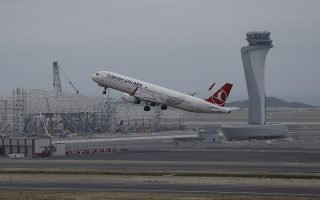 A Turkish Airlines plane takes off from Istanbul Airport near the Black Sea shores, in Istanbul, Saturday, April 6, 2019.  Turkey's main Ataturk International Airport is closing and moving to its new base at Istanbul Airport on the Black Sea shores, in a massive logistical operation. (AP Photo/Lefteris Pitarakis)
