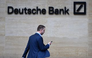 epa07537377 (FILE) - A man walks past by the British headquarters of the German Deutsche Bank in London, Britain, 30 September 2016 (re-issued 30 April 2019). President Trump, his children Donald Jr., Eric, Ivanka, along with his business, are suing Deutsche Bank and Capital One in an attempt to stop them from turning over financial records to Congress.  EPA/FACUNDO ARRIZABALAGA