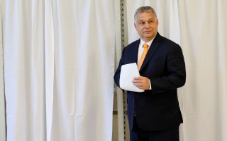 Hungarian Prime Minister Viktor Orban prepares to cast his ballot during the European Parliament Elections in Budapest, Hungary, May 26, 2019. REUTERS/Bernadett Szabo