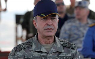 FILE PHOTO: Turkey's Hulusi Akar, when he was chief of the general staff, during the EFES-2018 military exercise near the Aegean port city of Izmir, Turkey May 10, 2018. REUTERS/Osman Orsal/File Photo