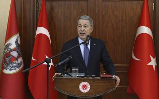 Turkey's Defense Minister Hulusi Akar speaks to a group of reporters in Ankara, Turkey, late Tuesday, May 21, 2019. Akar says Turkish military personnel are receiving training to operate the S-400 missile defense system despite U.S. and NATO objections to Ankara's decision to purchase the Russian technology. (Turkish Defense Ministry via AP, Pool)