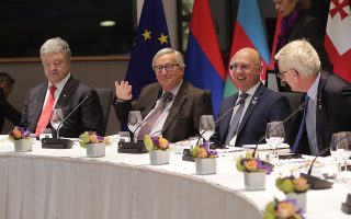 European Commission President Jean-Claude Juncker, second left, and Ukraine's President Petro Poroshenko, left, attend a dinner meeting of EU foreign ministers and Eastern partner nations at the Europa building in Brussels, Monday, May 13, 2019. (Olivier Hoslet, Pool Photo via AP)