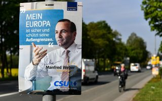 epa07553412 A campaign poster for the European People's  Party's (EPP/EVP) lead candidate Manfred Weber is seen in Lauf an der Pegnitz, Germany, 07 May 2019. The next elections to the European Parliament will be held between 23 and 26 May 2019.  EPA/PHILIPP GUELLAND