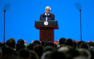 Greek President Prokopis Pavlopoulos delivers his speech during the opening ceremony of the Conference on Dialogue of Asian Civilizations in Beijing, China, Wednesday, May 15, 2019.(How Hwee Young/Pool Photo via AP)