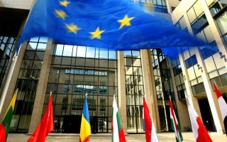 epa000212726 The flag of the European Union (top) stands at the entrance of  European council headquarters in Brussels Wednesday, 16 June  2004. EU leaders are facing a bruising battle over who will succeed Romano Prodi as president of the European commission when they meet for the crunch Brussels constitutional summit tomorrow. France and Germany have been supporting the prime minister of Belgium, Guy Verhofstadt, or his counterpart from Luxembourg, Jean-Claude Juncker, even though he has repeatedly insisted he is not available.  EPA/OLIVIER HOSLET