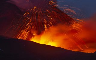 In this photo taken on Thursday, May 30, 2019 and made available Friday, May 31, 2019  Mount Etna volcano spews lava during an eruption. Mount Etna in Sicily has roared back into spectacular volcanic action from Thursday morning, sending up plumes of ash and spewing lava. (AP Photo/Salvatore Allegra)