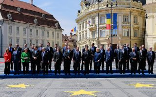 epa07557987 Officials attend a family photo ceremony during the Informal Summit of Heads of State or Government of the EU countries in Sibiu, Romania, 09 May 2019. EU leaders are expected to discuss the union's strategic agenda for the 2019-2024 period as well as exchanging views on EU challenges and priorities for the years to come.  EPA/BOGDAN CRISTEL