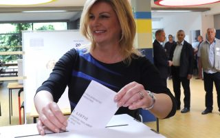 epa07601945 Croatian President Kolinda Grabar Kitarovic votes during the European Parliamentary elections in Zagreb, Croatia, 26 May 2019.The European Parliament election is held by member countries of the European Union (EU) from 23 to 26 May 2019.  EPA/ANTONIO BAT