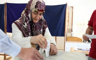 epa07602004 A Turkish Cypriot woman casts her vote during the European elections in Nicosia, Cyprus, 26 May 2019. Turkish Cypriot citizens crossed into the government-controlled areas of the Republic of Cyprus to vote at the European Parliament elections. The European Parliament election is held by member countries of the European Union (EU) from 23 to 26 May 2019.  EPA/KATIA CHRISTODOULOU