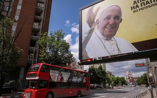A bus passes by a billboard promoting the upcoming visit of Pope Francis in Skopje, North Macedonia, May 6, 2019. REUTERS/Marko Djurica