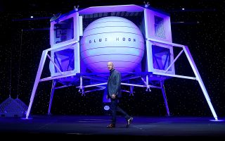 Founder, Chairman, CEO and President of Amazon Jeff Bezos unveils the BE-7 rocket engine that his space company Blue Origin's space exploration lunar lander rocket called Blue Moon will use during an unveiling event in Washington, U.S., May 9, 2019. REUTERS/Clodagh Kilcoyne