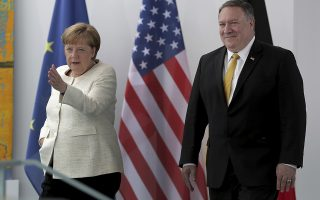 German Chancellor Angela Merkel, left, and U.S. Secretary of State, Mike Pompeo, right, arrive to a joint statement prior to a meeting at the chancellery in Berlin, Germany, Friday, May 31, 2019. (AP Photo/Michael Sohn)
