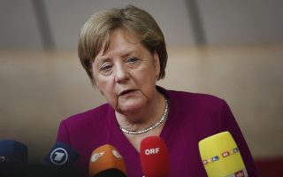 FILE - In this Tuesday, May 28, 2019, file photo, German Chancellor Angela Merkel speaks with the media as she arrives for an EU summit in Brussels. Merkel is set to address Harvard University graduates. The Ivy League school is hosting its 368th commencement ceremony Thursday, May 30, with a keynote speech from Merkel. (AP Photo/Francisco Seco)