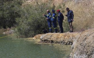 Rescuers stand next to a lake during a search operation for a six-year-old missing girl at the Xiliatos dam in Cyprus, April 22, 2019. REUTERS/Stringer