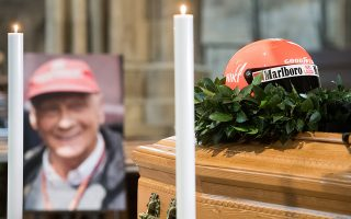 epa07609247 The helmet of Niki Lauda is on display in front of his portrait during his memorial service at Saint Stephen's Cathedral in Vienna, Austria, 29 May 2019. Austrian Formula One legend Niki Lauda died on 20 May 2019 at the age of 70. Lauda won the Formula One championship in 1975, 1977, and 1984 and founded three airlines.  EPA/MICHAEL GRUBER