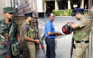 epa07564166 Sri Lankan Security personnel check people before they enter the church as services resume again after the Easter Sunday attacks, at the 'All Saints' Church in Colombo, Sri Lanka 12 May 2019. Security was on high alert in the island after at least 259 people were killed and hundreds more injured in a coordinated series of blasts during the Easter Sunday service at churches and hotels on 21 April 2019. The attacks were the worst violence the country had seen since its civil war ended a decade ago.  EPA/M.A.PUSHPA KUMARA