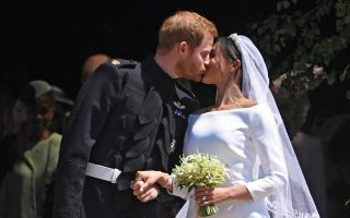Britain's Prince Harry (L) and Meghan Markle (R) kiss as they exit St George's Chapel in Windsor Castle after their royal wedding ceremony, in Windsor, Britain, 19 May 2018. The couple have been bestowed the royal titles of Duke and Duchess of Sussex on them by the British monarch. NEIL HALL/Pool via REUTERS - RC121E716240