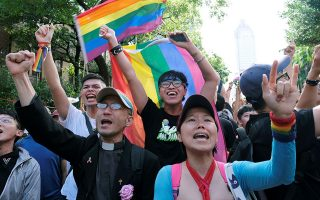 Same-sex marriage supporters celebrate after Taiwan became the first place in Asia to legalize same-sex marriage, outside the Legislative Yuan in Taipei, Taiwan May 17, 2019. REUTERS/Tyrone Siu