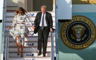 epa07598846 US President Donald J. Trump (R) and First Lady Melania Trump disembark from Air Force One as they arrive at Haneda International Airport in Tokyo, Japan, 25 May 2019. US President Trump is in Japan on a state visit.  EPA/JIJI PRESS JAPAN OUT EDITORIAL USE ONLY/  NO ARCHIVES