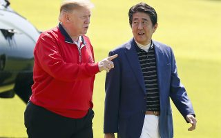 epa07601126 US President Donald J. Trump (L) and Japanese Prime Minister Shinzo Abe (R) talk while walking to the course for a game of golf at the Mobara Country Club in Mobara, Chiba Prefecture, Japan, 26 May 2019. US President Trump is in Japan on a four-day state visit.  EPA/KIMIMASA MAYAMA / POOL