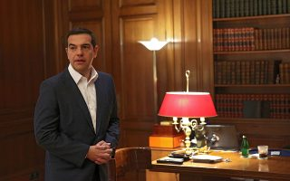 epa06806185 Greek Prime Minister Alexis Tsipras waits to welcome European Commission Vice President Valdis Dombrovskis for their meeting in Athens, Greece, 14 June 2018. While addressing a conference in Athens earlier the day, Dombrovskis said that Greece was in the final stretch before it successfully exits the financial assistance programme.  EPA/ORESTIS PANAGIOTOU