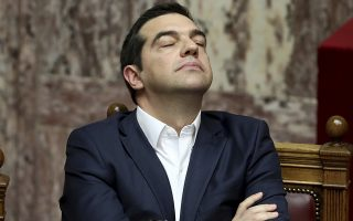 Greece's Prime Minister Alexis Tsipras reacts during a parliament debate about Prespa Agreement in Athens, Thursday, Jan. 24, 2019. Greek lawmakers are debating a historic agreement aimed at normalizing relations with Macedonia in a stormy parliamentary session scheduled to culminate in a Friday vote. (AP Photo/Yorgos Karahalis)