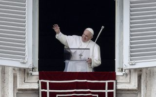 Pope Francis waves during the Regina Coeli noon prayer which he delivered from his studio window overlooking St. Peter's Square at the Vatican, Sunday, May 19, 2019. (AP Photo/Gregorio Borgia)