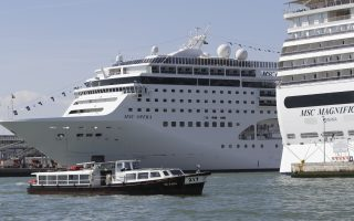 The MSC Opera cruise ship, left, is moored in Venice, Italy, Sunday, June 2, 2019. A towering, out-of-control cruise ship rammed into a dock and a tourist river boat on a busy Venice canal. Italian media reported that at least five people were injured. (AP Photo/Luca Bruno)