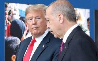 FILE PHOTO: US President Donald Trump (L) talks to Turkey?s President Recep Tayyip Erdogan (R) at NATO headquarters in Brussels, Belgium, 11 July 2018. NATO countries' heads of states and governments gather in Brussels for a two-day meeting. /Pool via REUTERS -/File Photo