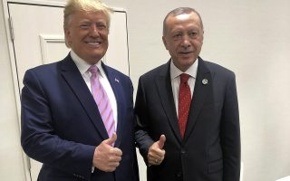 Turkey's President Recep Tayyip Erdogan, right, and U.S President Donald Trump gesture during the G-20 summit in Osaka, Japan, Friday, June 28, 2019. (Presidential Press Service via AP, Pool)