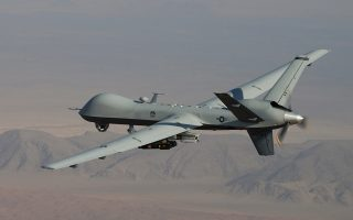 In this undated handout file photo provided by the U.S. Air Force, a MQ-9 Reaper, armed with GBU-12 Paveway II laser guided munitions and AGM-114 Hellfire missiles, is piloted by Col. Lex Turner during a combat mission over southern Afghanistan. The Air Force is taking several steps to fill a significant shortfall in drone pilots, laying out plans to increase incentive pay, bring more National Guard and Reserve pilots onto active duty, and seek volunteers to fill needed slots, Air Force Secretary Deborah Lee James said Thursday. (AP Photo/Lt. Col.. Leslie Pratt, US Air Force, File)