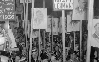 Oπαδοί του Δημοκρατικού Κόμματος πανηγυρίζουν για την εκ νέου λήψη του χρίσματος των Δημοκρατικών από τον πρόεδρο Φραγκλίνο Ρούζβελτ, ο οποίος θα διεκδικήσει για ακόμη μία φορά το προεδρικό αξίωμα, το 1936. (AP Photo)