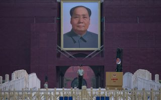 A Chinese paramilitary policeman stands guard in front of Mao Zedong's portrait on Tiananmen Gate on the 30th anniversary of a bloody crackdown of pro-democracy protesters in Beijing on Tuesday, June 4, 2019. Critics say the 1989 Tiananmen crackdown, which left hundreds, possibly thousands, dead, set the ruling Communist Party on its present course of ruthless suppression, summary incarceration and the frequent use of violence against opponents in the name of
