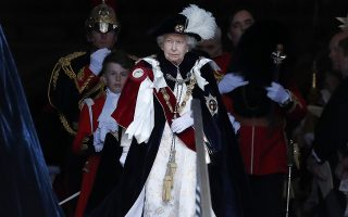 Britain's Queen Elizabeth II leaves the Order of The Garter Service at Windsor Castle in Windsor, Monday, June 17, 2019. Windsor Castle plays host to the annual Order of the Garter Service, held in St. George's Chapel, which celebrates the traditions and ideals associated with the Most Noble Order of the Garter, the oldest surviving order of chivalry in the world.(AP Photo/Frank Augstein, Pool)