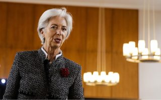 Christine Lagarde, Managing Director of the International Monetary Fund (IMF) arrives for a lecture about 'Strengthening the Euro Area Architecture' hosted by German Institute for Economic Research in Berlin, Germany, Monday, March 26, 2018. (AP Photo/Markus Schreiber)