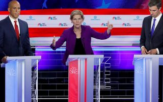 FILE PHOTO: U.S. Senator Elizabeth Warren speaks as U.S. Senator Cory Booker and former U.S. Rep. Beto O'Rourke listen at the first U.S. 2020 presidential election Democratic candidates debate in Miami, Florida, U.S., June 26, 2019. REUTERS/Mike Segar/File Photo