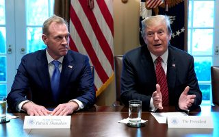 FILE PHOTO: Acting Defense Secretary Patrick Shanahan  (L) listens as U.S. President Donald Trump holds a meeting with senior military leaders at the White House in Washington, U.S., April 3, 2019.  REUTERS/Kevin Lamarque/File Photo