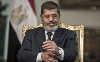 epa07654253 (FILE) - Egyptian President Mohamed Morsi gesturing during an interview with Spanish news agency EFE, in Cairo, Egypt, 04 May 2013 (reissued 17 June 2019). Reports state Morsi died on 17 June 2019 during a trial session in an espionage case.  EPA/OLIVER WEIKEN *** Local Caption *** 51936097