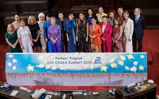 Akie Abe, the wife of Japan's prime minister, poses for a family photo with the partners of G20 leaders during the G20 Partners' Program at a symposium in Osaka, Japan, June 29, 2019. Nicolas Datiche/Pool via REUTERS