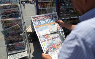 epa07670242 A man checks the Turkish newspaper in Istanbul, Turkey, 24 June 2019. According to the election preliminary results., Ekrem Imamoglu won the election with 54 percent of the votes. The Turkish Electoral Commission ordered a repeat of the mayoral election in Istanbul for 23 June 2019, after Turkish President Erdogan's AK Party had alleged there was 'corruption' behind his party losing to a candidate of main opposition Republican People's Party's (CHP) in the 31 March 2019 polls.  EPA/ERDEM SAHIN