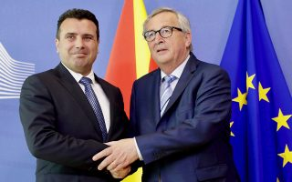 European Commission President Jean-Claude Juncker, right, greets North Macedonia's Prime Minister Zoran Zaev prior to a meeting at EU headquarters in Brussels, Tuesday, June 4, 2019. (AP Photo/Olivier Matthys)