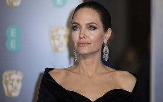 Angelina Jolie poses for photographers upon arrival at the BAFTA Film Awards, in London, Sunday, Feb. 18, 2018. (Photo by Vianney Le Caer/Invision/AP)