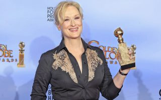 Actress Meryl Streep poses with her award for best performance by an actress in a motion picture - drama for