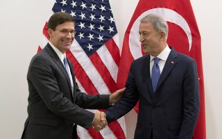 epa07674605 Acting US Secretary for Defense Mark Esper (R) greets Turkish Defense Minister Hulusi Akar prior to a meeting of NATO defense ministers at NATO headquarters in Brussels, Belgium, 26 June 2019. NATO Defense ministers  gather in Brussels on 26-27 June.  EPA/VIRGINIA MAYO / POOL