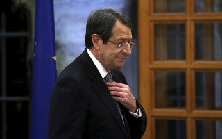 FILE - In this Tuesday, Nov. 6, 2018 file photo, Cyprus' president Nicos Anastasiades adjusts his tie before giving a statement to the media at the presidential palace in divided capital Nicosia, Cyprus. Cyprus' government spokesman says on Saturday, June 29, 2019, President Nicos Anastasiades, 72, has suffered a fracture of his femur, or thighbone, on this right leg and will undergo surgery. (AP Photo/Petros Karadjias, File)
