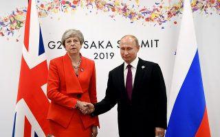 epa07679260 British Prime Minister Theresa May (L) holds talks with Russian President Vladimir Putin (R) on the first day of the G20 summit in Osaka, Japan, 28 June 2019. It is the first time Japan hosts a G20 summit. The summit gathers leaders from 19 countries and the European Union to discuss topics such as global economy, trade and investment, innovation and employment.  EPA/ANDY RAIN / POOL