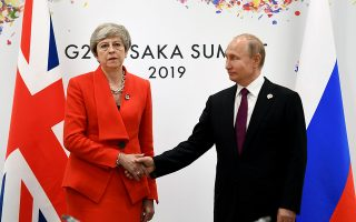 epaselect epa07679264 British Prime Minister Theresa May (L) holds talks with Russian President Vladimir Putin (R) on the first day of the G20 summit in Osaka, Japan, 28 June 2019. It is the first time Japan hosts a G20 summit. The summit gathers leaders from 19 countries and the European Union to discuss topics such as global economy, trade and investment, innovation and employment.  EPA/ANDY RAIN / POOL