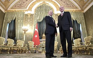 Russian President Vladimir Putin, left, and Turkish President Recep Tayyip Erdogan shake hands during their meeting in the Kremlin in Moscow, Russia, Monday, April 8, 2019. The talks are expected to focus on the situation in Syria, where the two countries have closely coordinated their steps. (Alexei Nikolsky, Sputnik, Kremlin Pool Photo via AP)